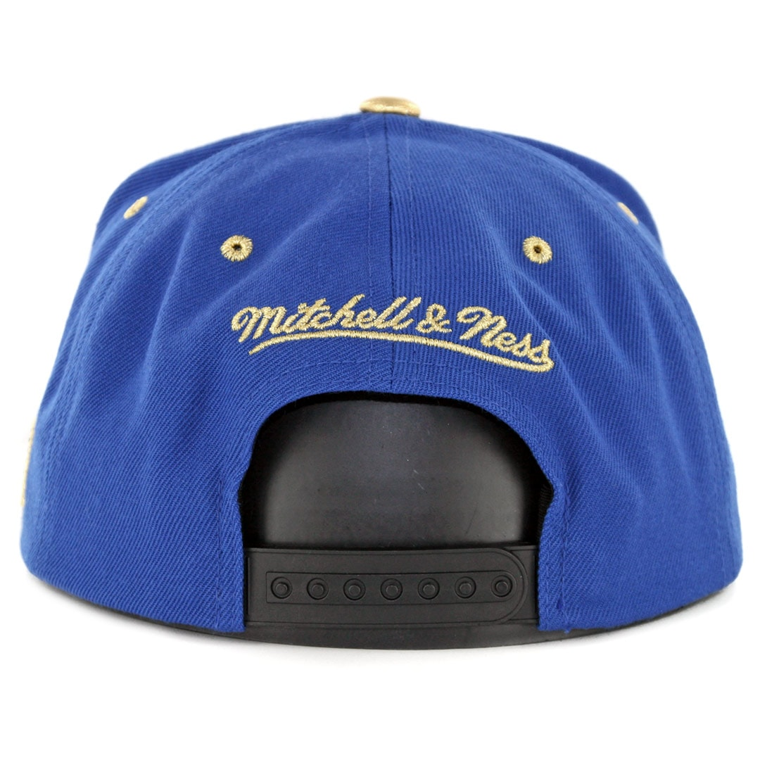 pretty nice f6111 c229d Mitchell   Ness Golden State Warriors Gold Tip Snapback Hat Royal Blue  Black. 🔍.  35.00