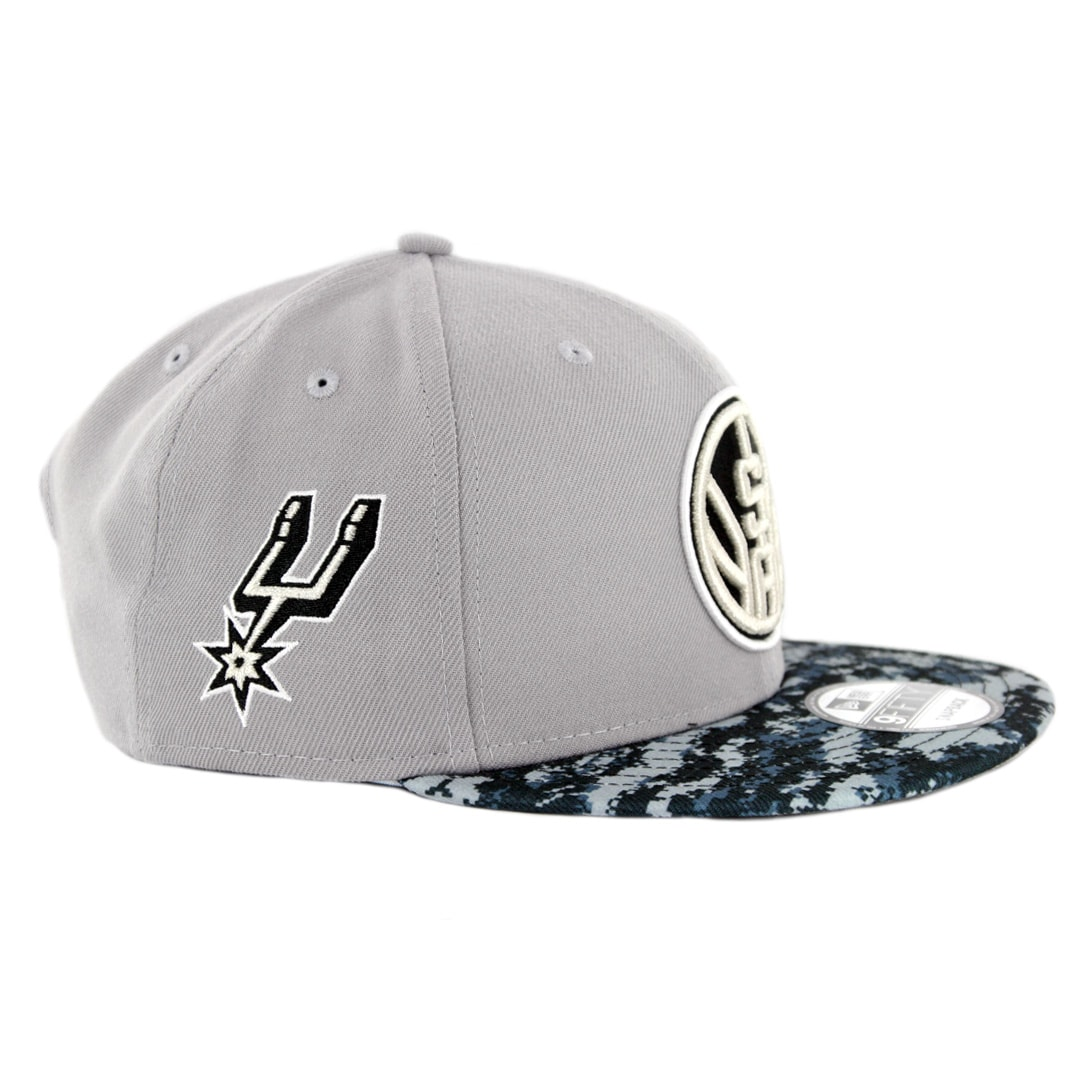 huge selection of 50ea4 e1cb7 New Era 9Fifty San Antonio Spurs Alternate City Series 2018 Snapback Hat  Grey Digi Camo Blue. 🔍.  34.00
